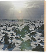 Sun Shining On A Field Of Lava Rocks Wood Print