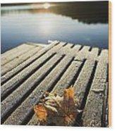 Sunrise Over Leaf On Floating Dock In Wood Print