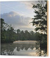 Sunrise With A Jet Trail Wood Print