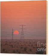 Sunset On Pylons In Dubai Desert Wood Print