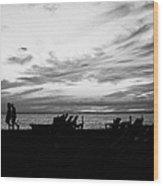 sunset over couple walking along the beach at playa de las americas Tenerife Canary Islands Spain Wood Print
