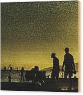 Sunset Silhouette Of People At The Beach Wood Print