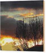 Sunset Through The Clouds Wood Print