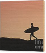 Surfer Crossing Wood Print by Paul Topp