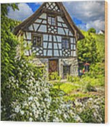 Swiss Chalet In The Garden Wood Print by Debra and Dave Vanderlaan