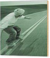 Teenager Skateboarding Down Road Wood Print