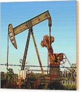 Texas Pumping Unit Wood Print by Kathy  White