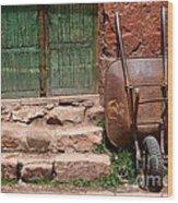 Rusty Wheelbarrow And Green Door Wood Print