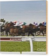 The Blur Of Racehorses Racing By The Rails On A Race Track  Wood Print
