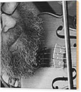 The Busker Wood Print by Stephen Norris