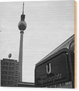 the christmas market in Alexanderplatz with the Berlin Fernsehturm and U-bahn sign Germany Wood Print by Joe Fox