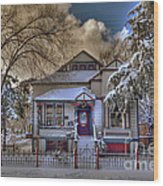 The Decorated Little House In The Snow Wood Print