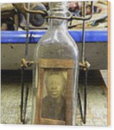 The Face In The Bottle  Wood Print