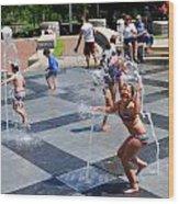 Joyful Young Girl Playing In Fountain Wood Print