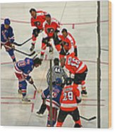 The Faceoff Wood Print by David Rucker