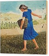 The Sower Of The Seed Wood Print by Clive Uptton