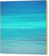 The Turquoise Sea Wood Print