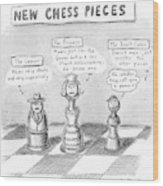 Three Chess Pieces Are Seen On A Chess Board Wood Print