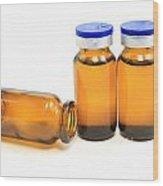Three Glass Bottles With Medicine Wood Print