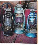 Three Kerosene Lamps Wood Print