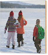 Three Kids Heading Out To Ice Skate Wood Print