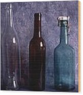 Three Old Empty Bottles On Painted Background Wood Print by IB Photo