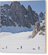 Three People Ski-tour On Karale Glacier Wood Print