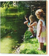 Three Sisters Watching Koi Wood Print
