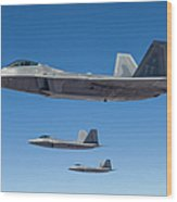 Three U.s. Air Force F-22 Raptors Wood Print