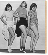 Three Women Lift Their Skirts Wood Print by Underwood Archives