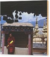 Tibetan Monk With Scroll On Jokhang Roof Wood Print