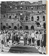 Tour Guide Explains To Group Of British Tourists About Gladiator Pits On The Floor Of The Arena Of The Old Roman Colloseum At El Jem Tunisia Vertical Wood Print