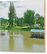 Tourist Raft Being Towed On River Kwai In Kanchanaburi-thailand Wood Print