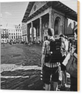 tourists watching street performers in covent garden London England UK Wood Print