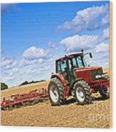 Tractor In Plowed Farm Field Wood Print by Elena Elisseeva
