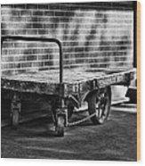 Train Depot Baggage Cart In B/w Wood Print