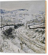 Train In The Snow At Argenteuil Wood Print by Claude Monet