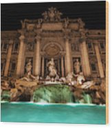Trevi Fountain Illuminated At Nighttime Wood Print