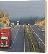 Trucks Driving Through A Misty Mountain Pass Wood Print