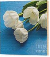 Tulip Flowers Over Blue Wood Print