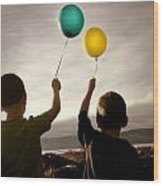 Two Children With Balloons Wood Print