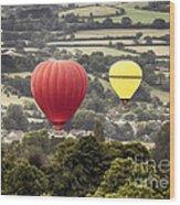 Two Hot Air Baloons Drifting Wood Print