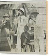 Two Men In Tropical Clothing And A Woman Drinking From Bowls Wood Print