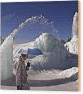 Umbrella Man At Frozen Fountain Wood Print