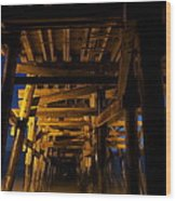 Under The Pier At Night Wood Print