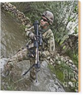 U.s. Army Soldier Walks Through A Creek Wood Print