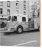 Vancouver Fire Rescue Services Truck Engine 2 Speeding Through Downtown City Streets Bc Canada Delib Wood Print by Joe Fox