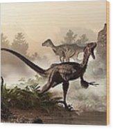 Velociraptors Prowling The Shoreline Wood Print