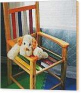 Vertical Of Dog In Kid Chair. Wood Print