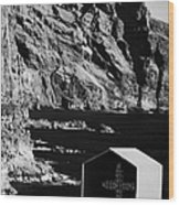 vertical small shrine with cross made out of sea shells on rocky coastline at punta de teno Tenerife Canary Islands Spain Wood Print